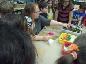 Giving a demo on a textured collage to 3rd graders during my student teaching.