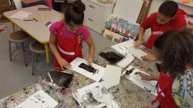 fourth graders working on social justice prints