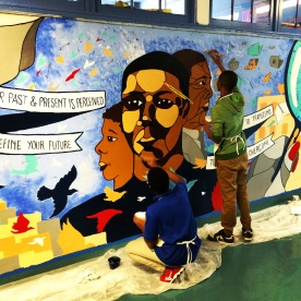 Students finishing our mural at Bronx High School for Writing and Communication Arts in 2016.